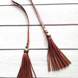 Робота Кожаные украшения для сумок