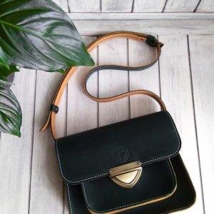 Робота Женская кожаная сумка зелёного цвета.